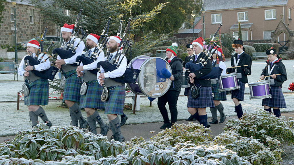 Lochaber Pipe Band leads the Santa procession through the Parade. Photograph: Iain Ferguson, alba.photos