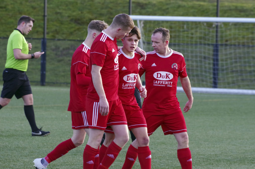 Young Aaron McKay is congratulated on opening his Saints goalscoring account.
