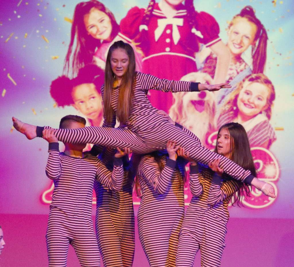 Some of the pupils performing It's a Hard Knock Life from Annie the Musical. Photograph: Kevin McGlynn.