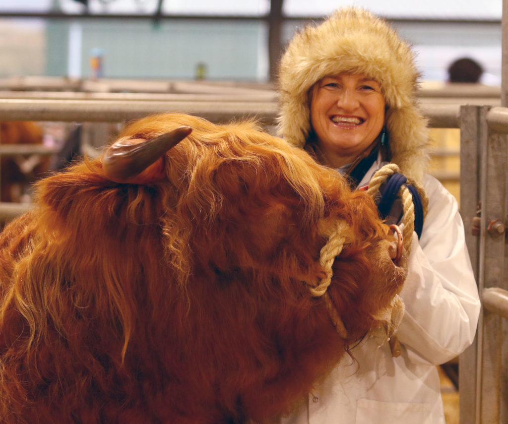 With Storm Ciara bringing stong winds and rain to the west coast, it was cold for those showing and selling highland cattle at Oban Livestock Centre . But Liz Craig kept smiling and proved if you want to get ahead get a warm hat. NO_T07_HighlandCattleShow06_Photograph Kevin McGlynn