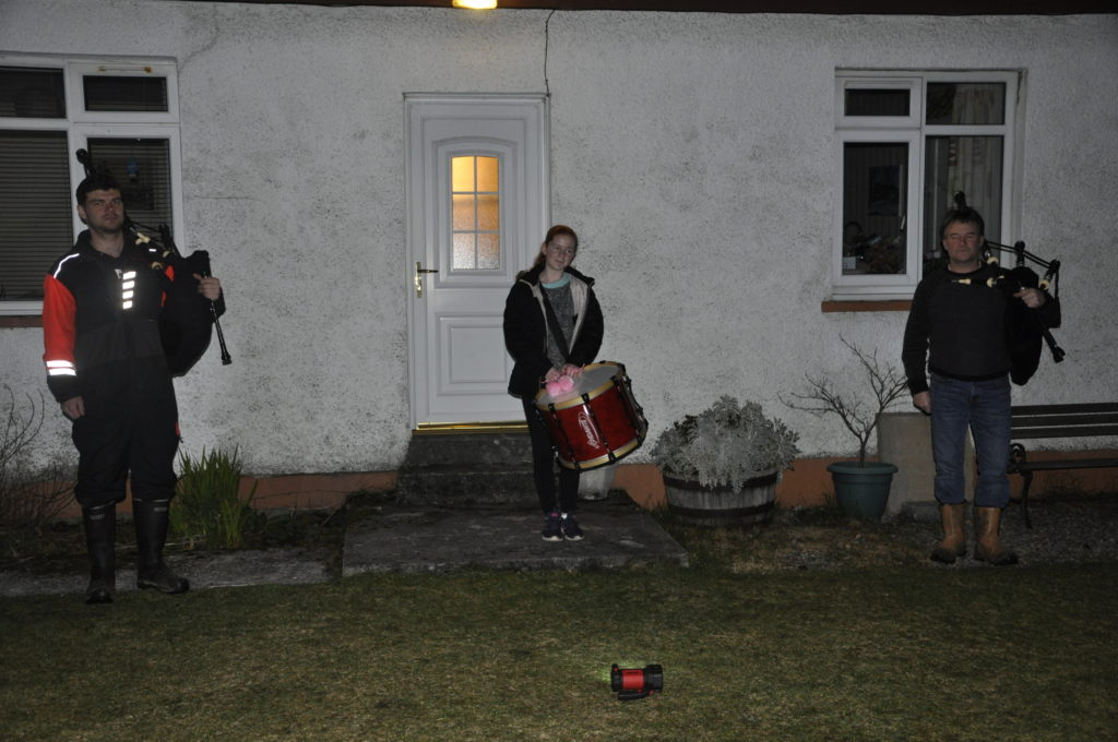 OHS Pipe Band pipe major Angus MacColl (right), his son Angus John and niece Fiona Cruikshanks played from their family home at Keil Crofts, Benderloch.