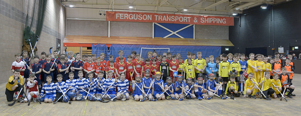 The 11 P6/P7 teams from across Scotland who took part in the Ferguson Transport & Shipping National First Shinty Festival in the Nevis Centre, Fort William. Photograph: Iain Ferguson, alba.photos