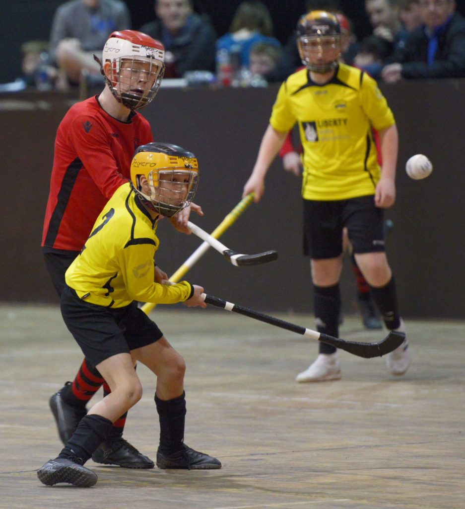 First Shinty action from the final between Inverlochy and Phort Righ. Photograph: Iain Ferguson, alba.photos