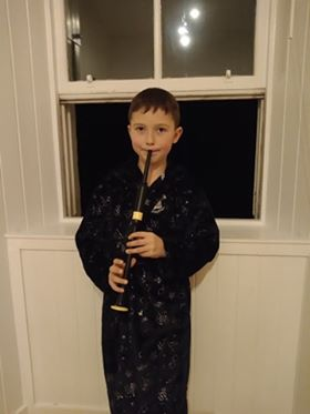 Cody McCuigan (chanter) and his big brother Calan (pipes) played from their bedroom windows.