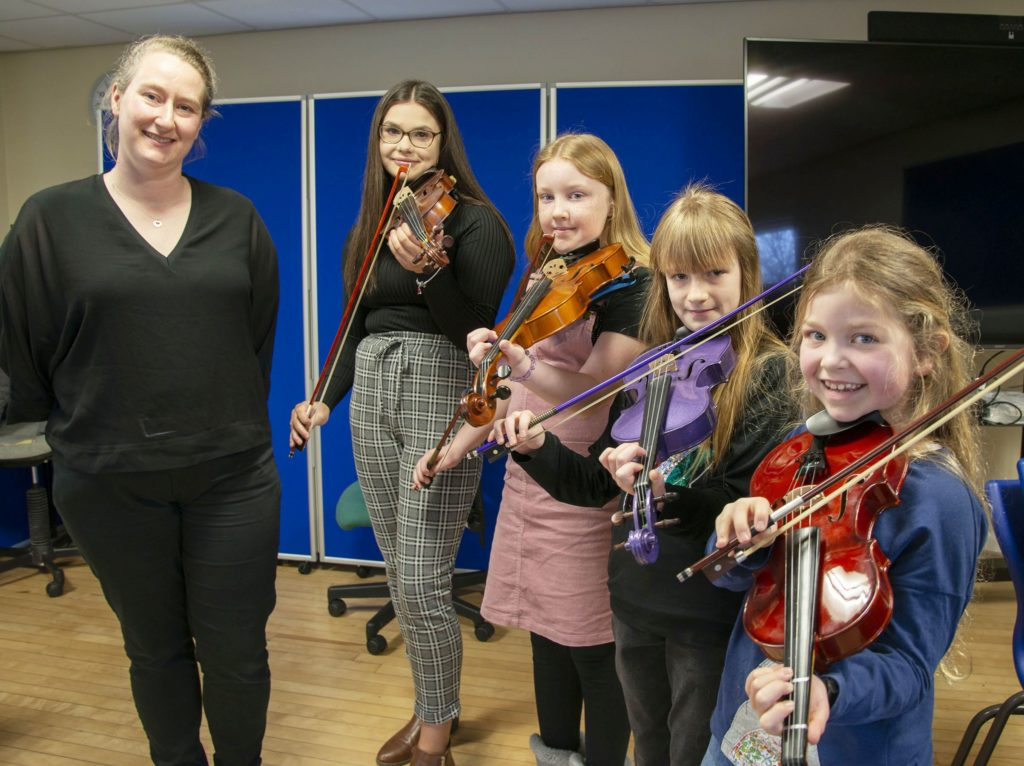 MUSIC FESTIVAL  Fiddle Judge, Gillian Frame (left) with young contestants (left - right)  Sophie Rand, Kayla Milne, Eliza Moffat and Aisling Flavin.  Photograph: Iain Ferguson, alba.photos