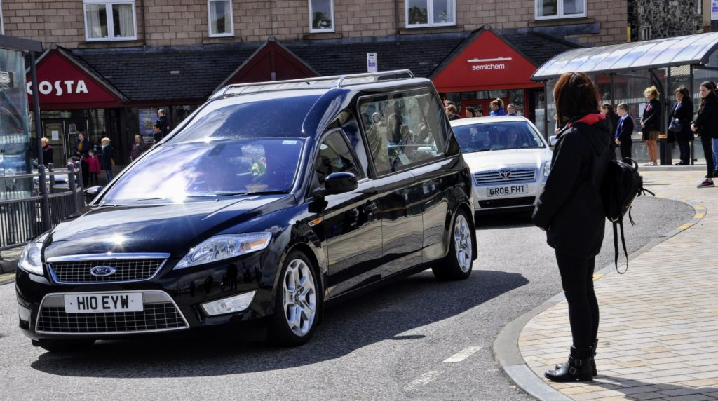 Children and parents lined the streets to say goodbye to Mrs Cain