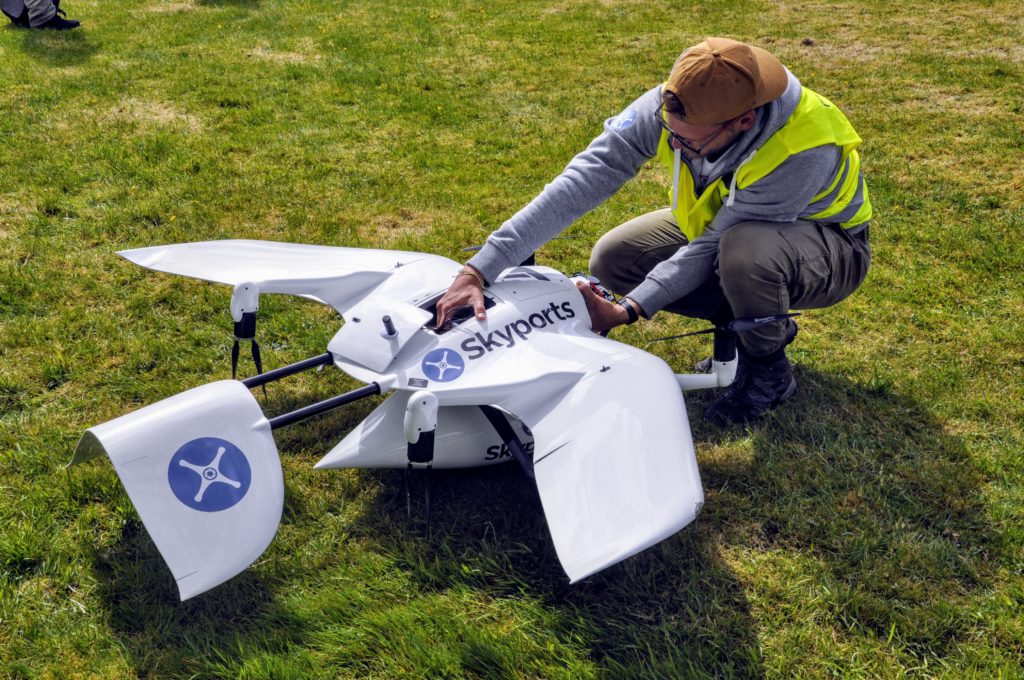 A member of the test crew gives the drone the once over