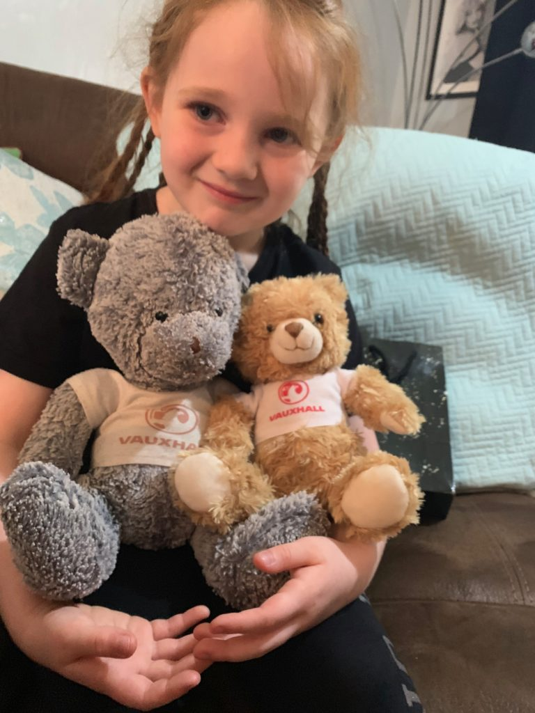 "Charlie Louise Russell from Caol was seven on May 24. For her birthday this year her family had planned on taking her and her best friend Kaelynn for a day trip but due to lockdown they couldn't. Charlie didn't ask for much for her birthday apart from a Vauxhall Motors teddy bear to join her other bear Griffin and some clothes with the Vauxhall badge for her bears. Her family were able to find some items online so she had some presents, a BBQ and spoke with family. She   named her new bear Nova and her amazing grandma Margaret Smith made some new clothes for her other bear Griffin. She is looking forward to spending her birthday money when lockdown is over and she can buy something for her and Kaelynn on their day trip. She can't wait till the hairdressers are open as she is donating 12"" of her beautiful hair to The Princess Trust so that another little girl will get all the kind comments about the beautiful hair that Charlie gets from people. 'Charlie is the most kind and understanding good natured girl and we love her to Ben Everest and back' - Laura Russell- muma to Charlie Louise."