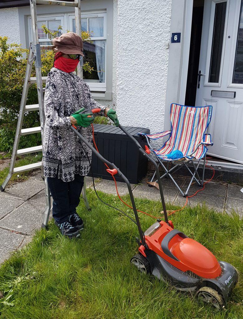 Lockdown Lettie makes herself useful mowing the lawn.
