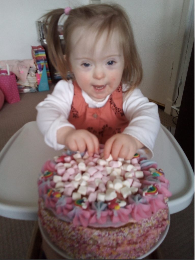 Esther Napier from Oban celebrated her 2nd birthday on May 12, She got to eat lots of cake on her birthday.