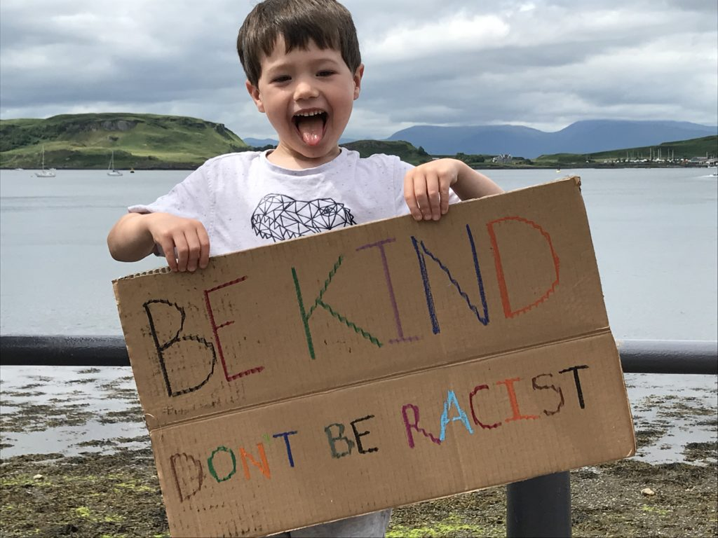 Little Oran MacKay came from Dunbeg with mum Briana Brewer and baby sister Aoife MacKay urging people to 'Be Kind, don't be racist.'