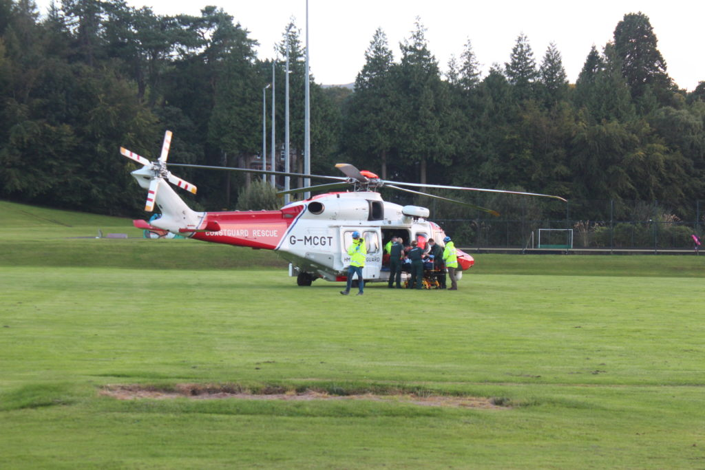 An injured passenger is put in a helicopter to be airlifted to hospital.