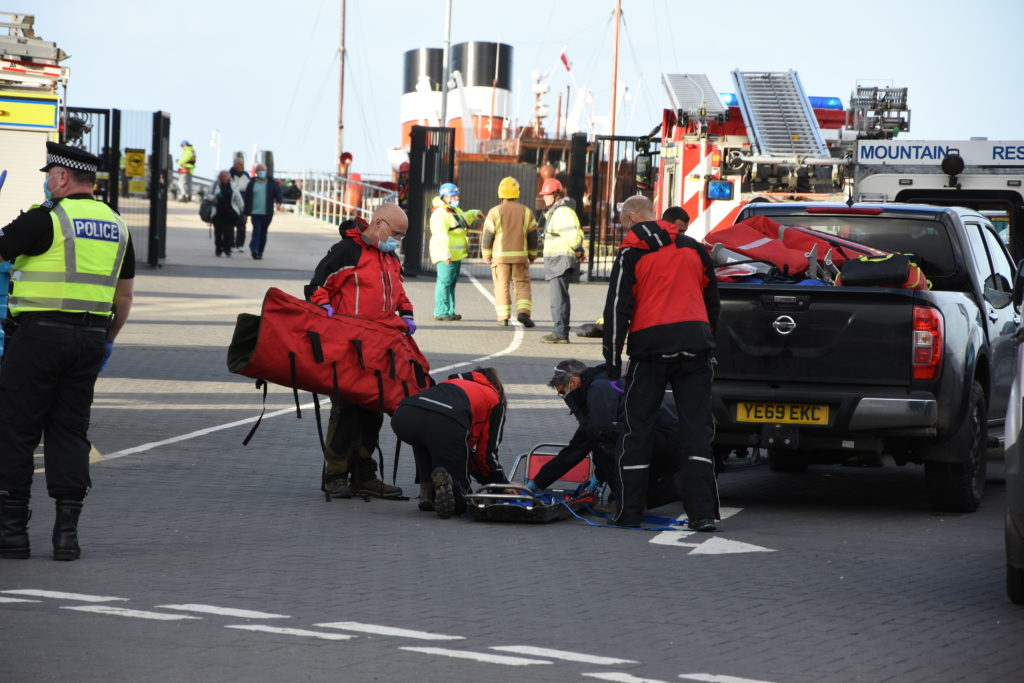 The mountain rescue team prepare stretchers at the quayside.