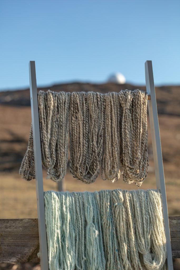 Handspun yarn drying outside.