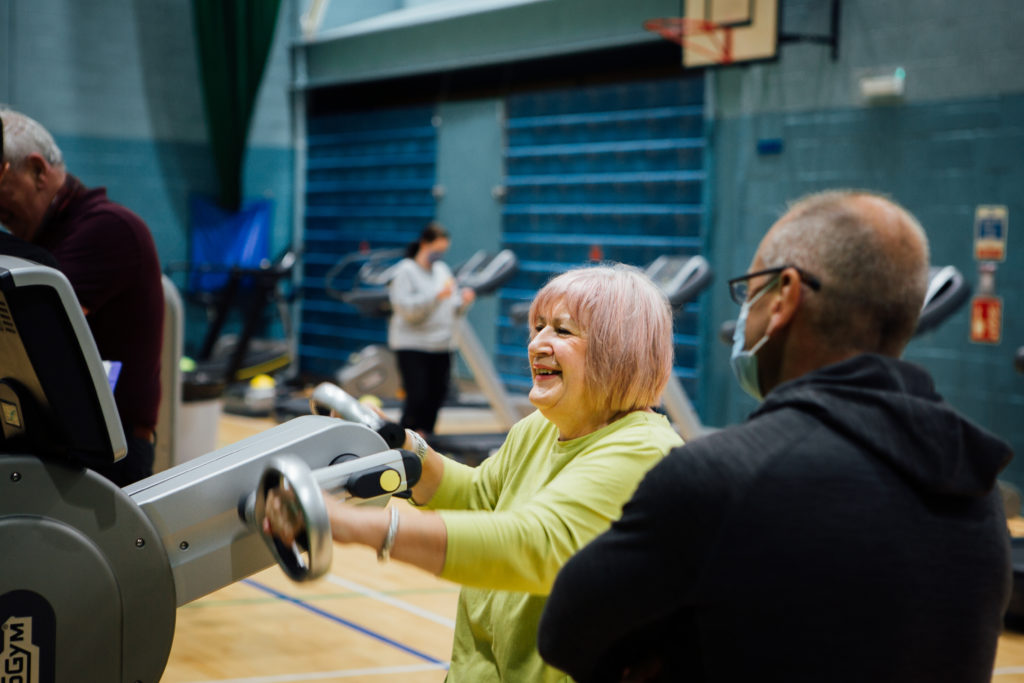 Exercise professional Ian Milarvie helps Healthy Otions client Katherine MacNaughton get to grips with the gym equipment.