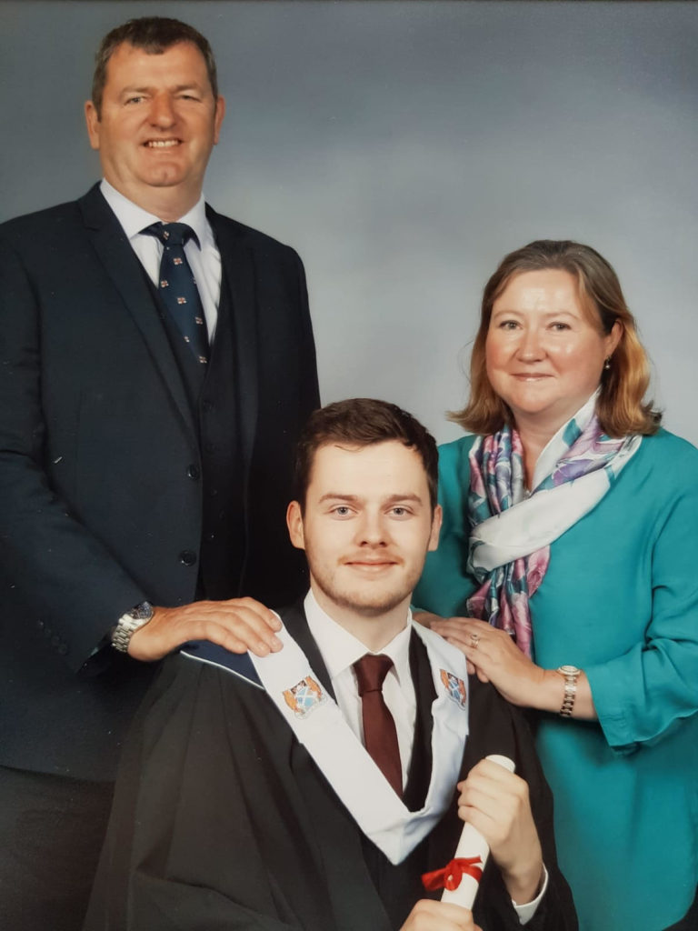 Karen Scott with two generations of lifeboat crew, her husband Mark and son Andrew
