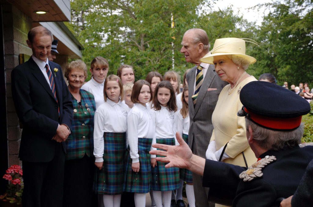 he Queen and Prince Philip arrive at the GLen Nevis Restaurant to the voices of Coisir Og Lochaber gaelic choir in 2005. Photograph by Iain Ferguson, The Write Image.