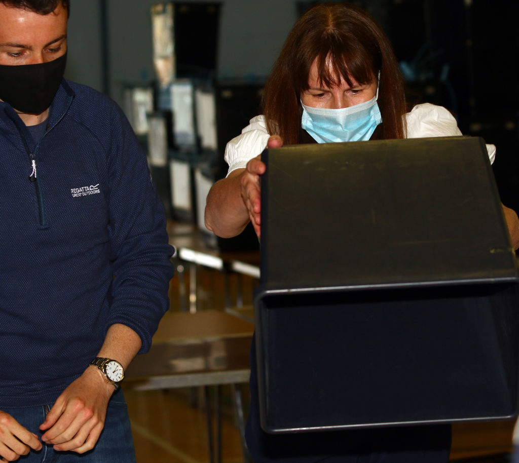 Worker are busy counting the votes. Photograph: Kevin McGlynn