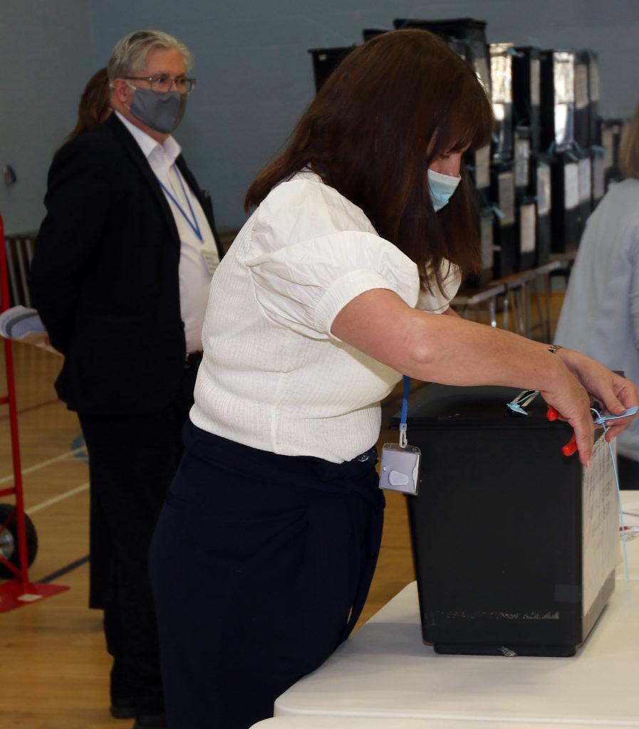 Gemma Cummings cuts the tag on ballot box watched by David Logan. Photograph: Kevin McGlynn