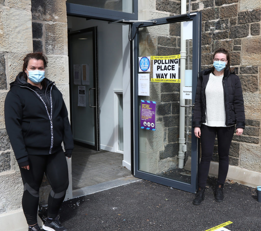 Ladies were on hand to direct voters to the right area of the polling station in Oban. Photograph: Kevin McGlynn