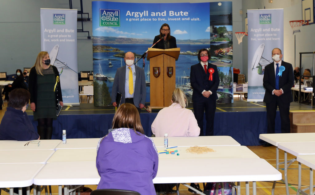 The candidates wait nervously for Returning Officer Pippa Milne to announce the winner. Photograph: Kevin McGlynn