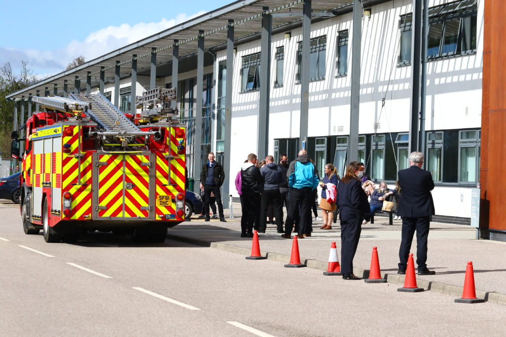 Pippa Milne and David Logan wait for firefighters to give staff the all clear to return to the building. Photograph: Kevin McGlynn