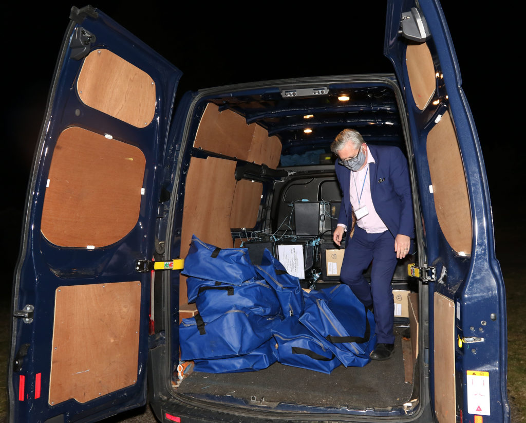 David Logan checks ballot boxes as they are stacked in the transit van before being driven to the count. Photograph: Kevin McGlynn