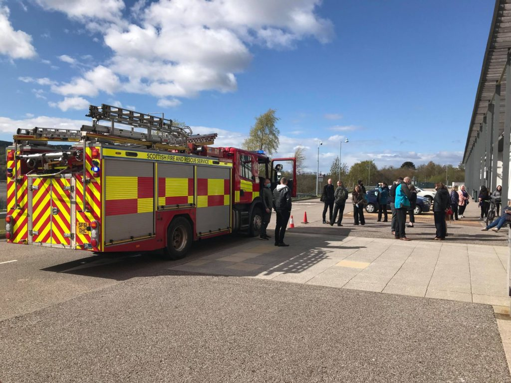 Count staff wait patiently to be allowed to return to the count following a fire alarm. Photograph: Kevin McGlynn