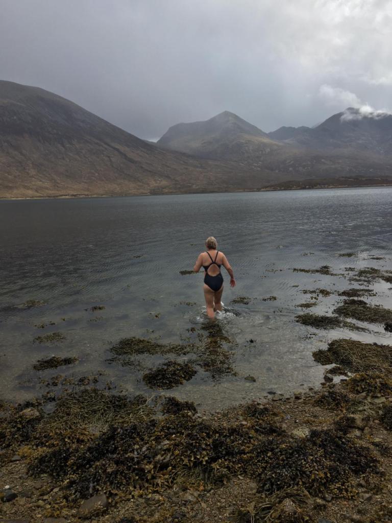 Walking into Loch Ainort in Skye.
