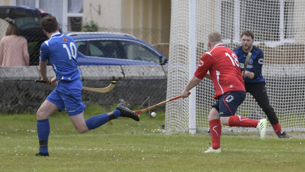 More action from the game. Photograph: Iain Ferguson, The Write Image.