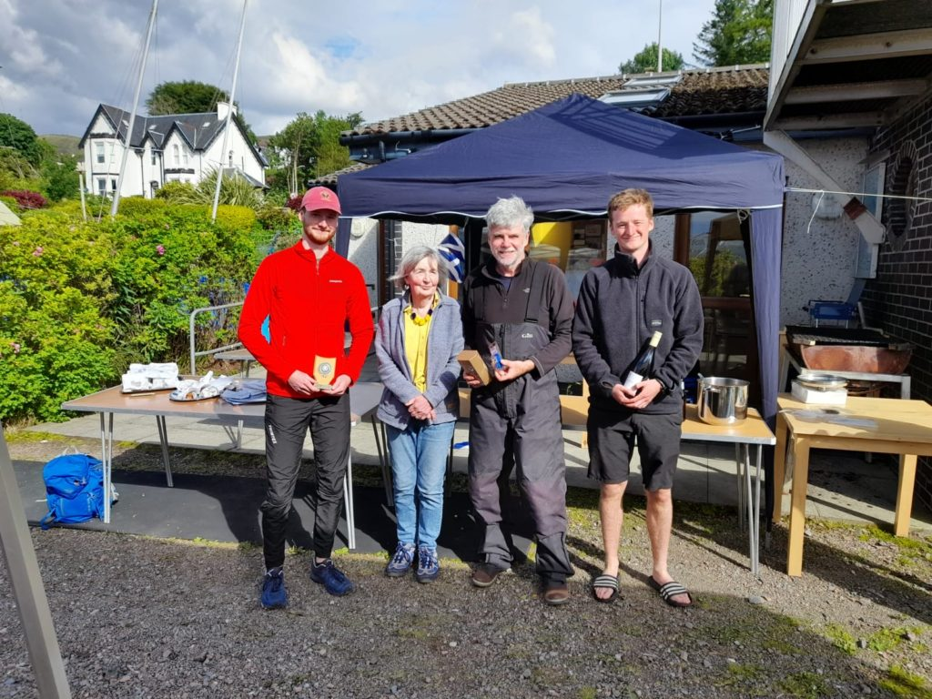 Liz Loudon presents  Euan Fundingsland, Andy McKenna and  Liam Fundingsland with their runners-up prizes.