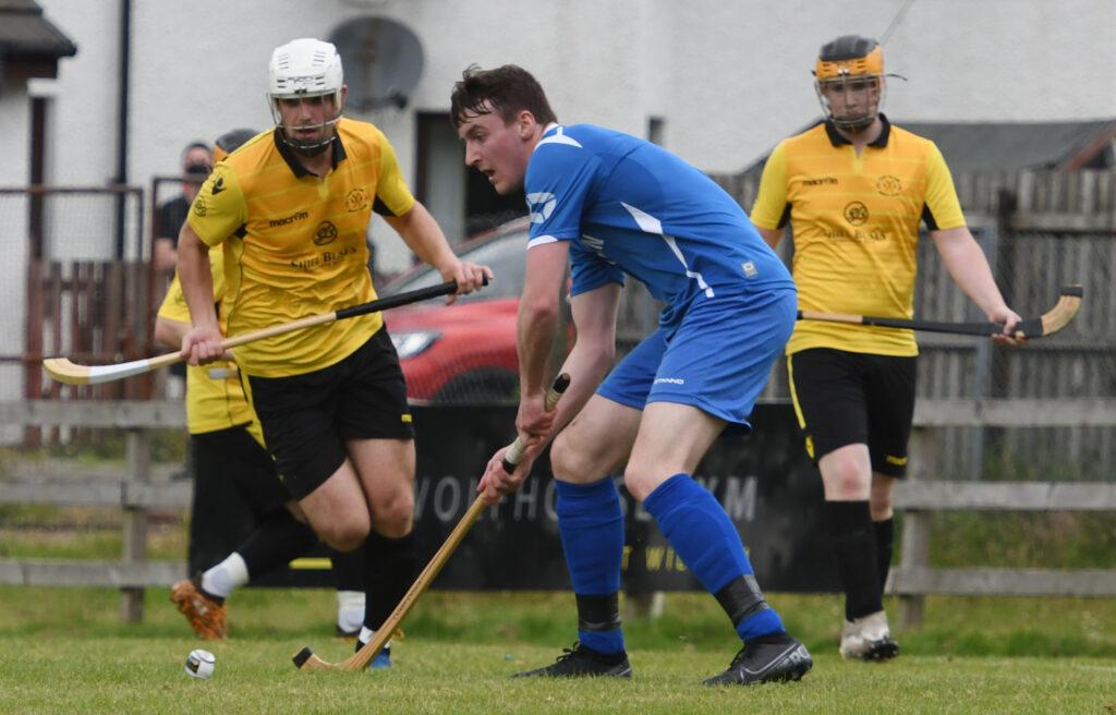 Innes Blackhall defends his goal against strong Fort opposition.  Photograph:  Iain Ferguson, alba.photos
