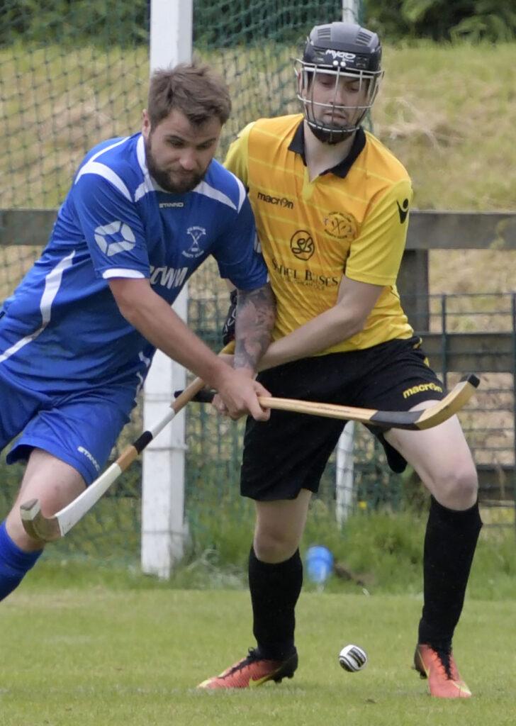 Kilmallie's Andrew McAlister takes the ball from Padraig MacNeil. Photograph: Iain Ferguson, alba.photos