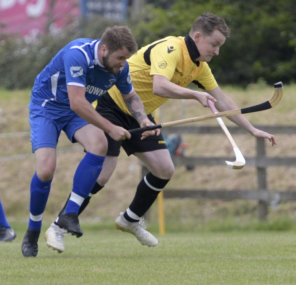 Kilmallie's Andrew  MacAlister is tackled by Jack Fraser. Photograph: Iain Ferguson, alba.photos
