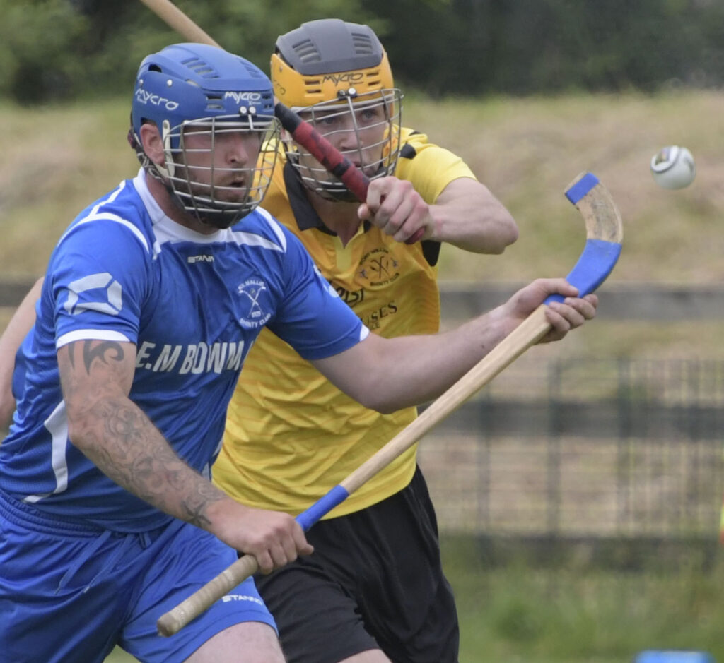 Fort William's Hamish Shaw tackles Kilmallie's Liam Cameron.  Photograph: Iain Ferguson, alba.photos