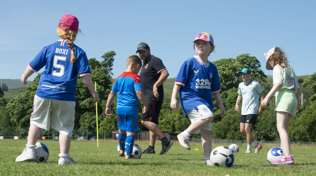 Some dribbling skills in the sunshine at Caol.  NO F31 Spud Footie 02