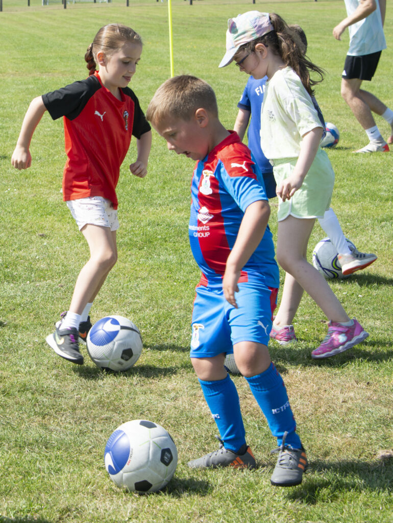 The youngsters were clearly serious about practising their skills.  NO F31 Spud Footie 03