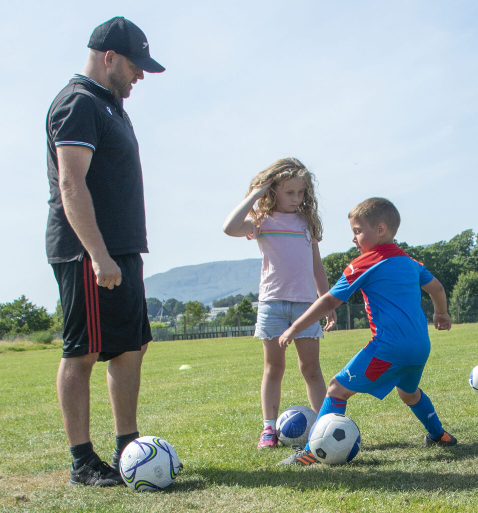 The coaches made sure the young players had a great time.  NO F31 Spud Footie 05