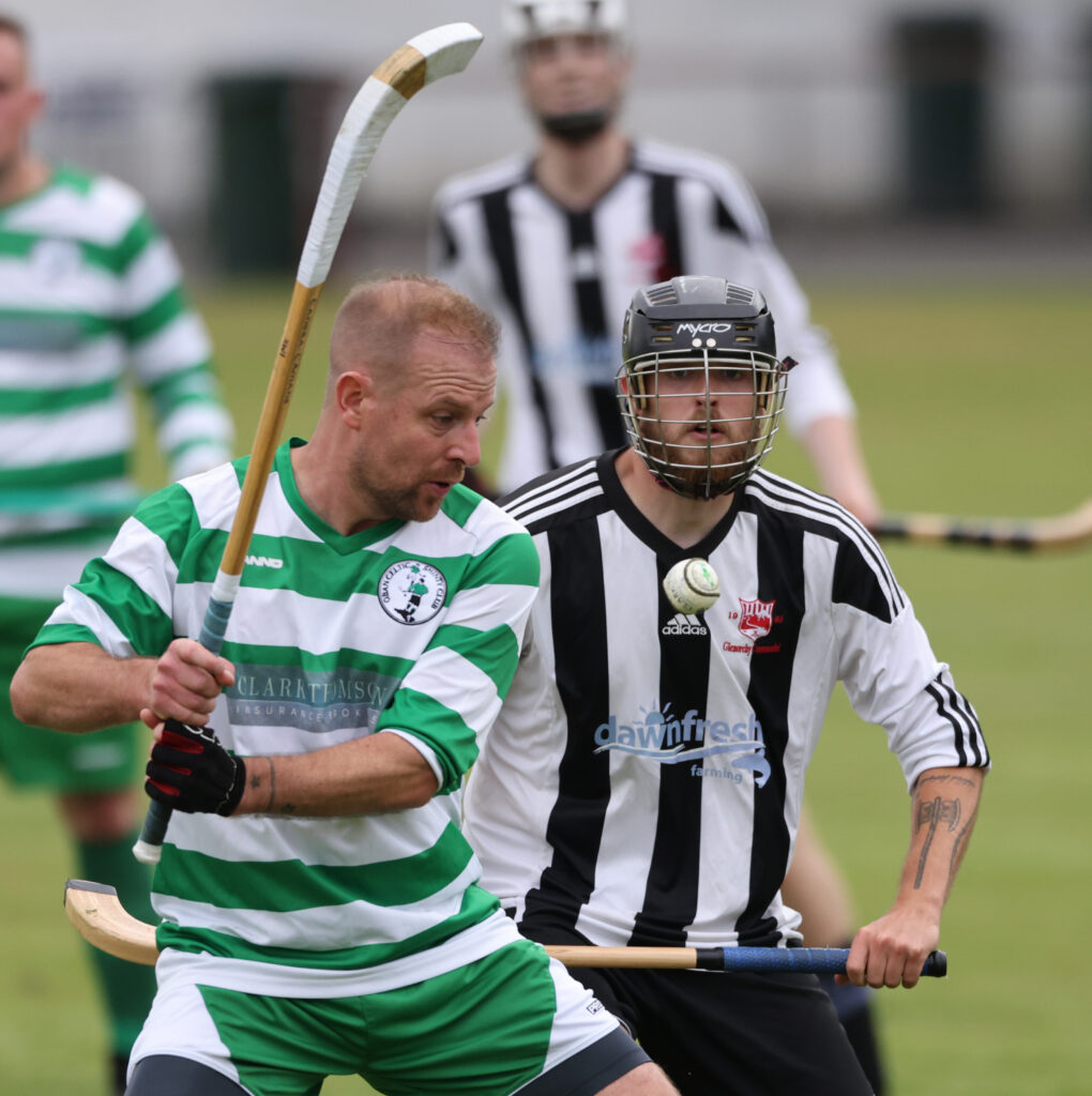 Iain MacKechnie, Oban Celtic, clears despite the attention of Arik MacKechie, Glenorchy, at Mossfield Stadium. Photograph: Kevin McGlynn.