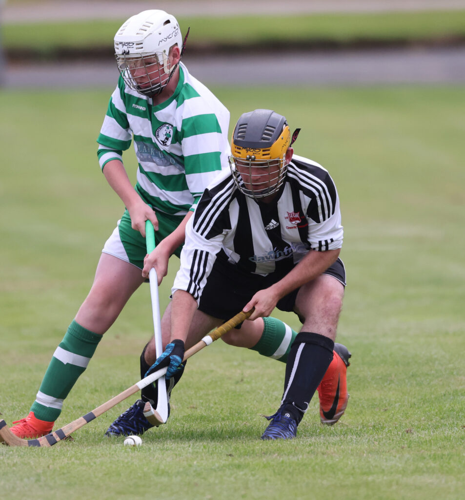 Logie Johnson of Oban Celtic battles with Roddie Cairns, Glenorchy, at Mossfield Stadium. Photograph: Kevin McGlynn.