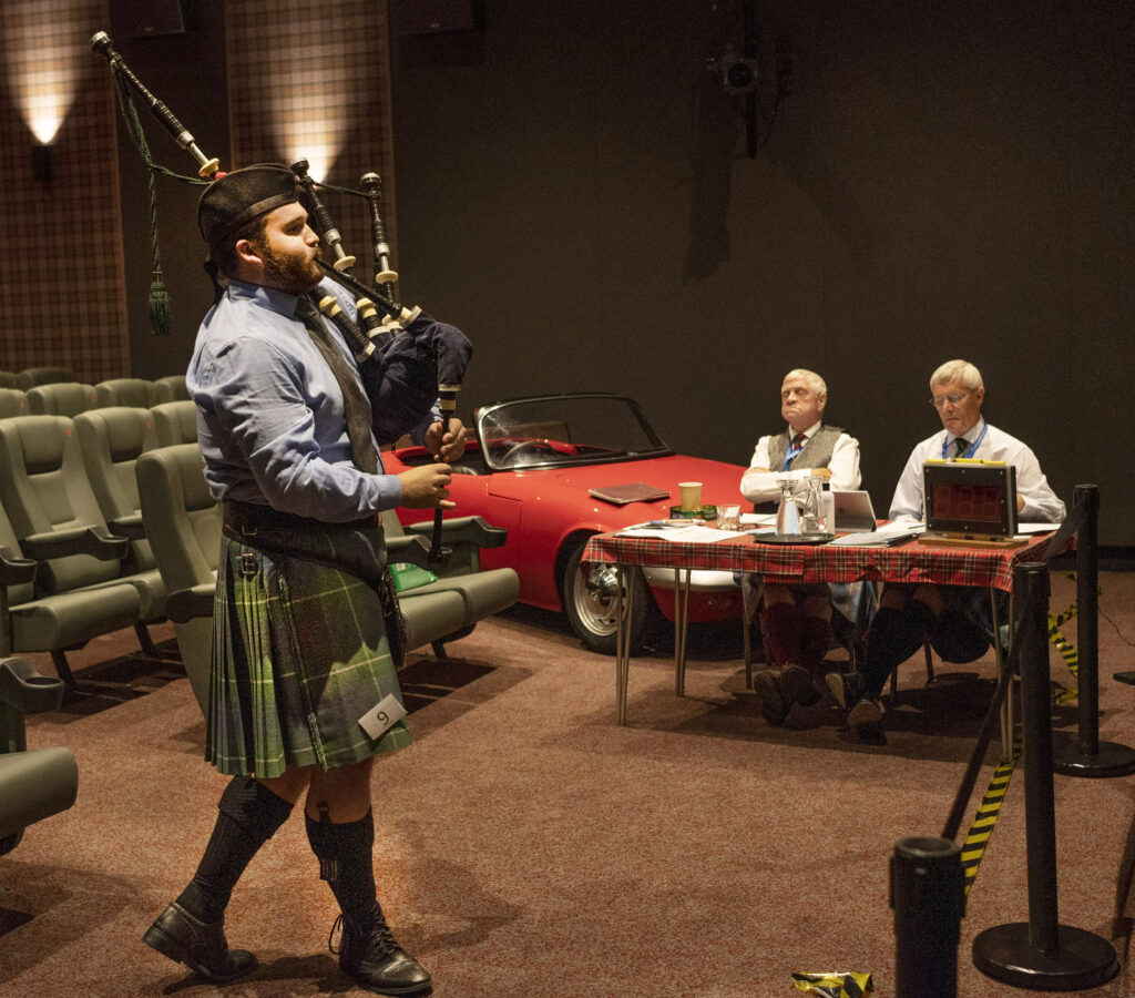 Angus MacPhee performs to judges in front of the silver screen rather than on it during the Lochaber Gathering in Fort William's cinema. Photograph: Iain Ferguson, alba.photos  NO F36 Lochaber Gathering 04