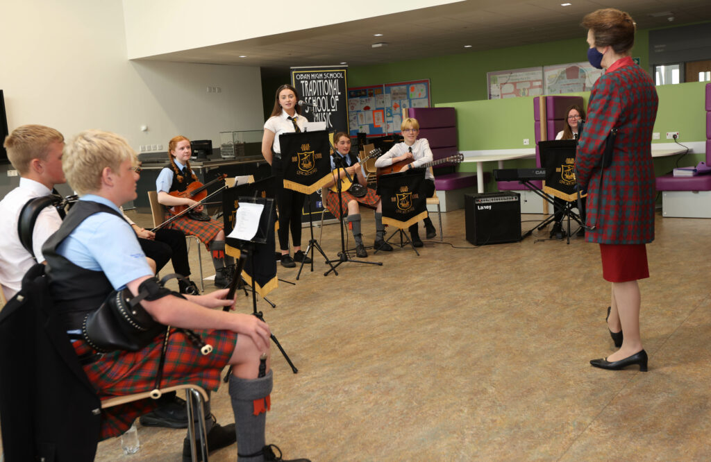 Princess Anne chats to members of Oban High School traditional school of music after they had performed during her visit to the school campus