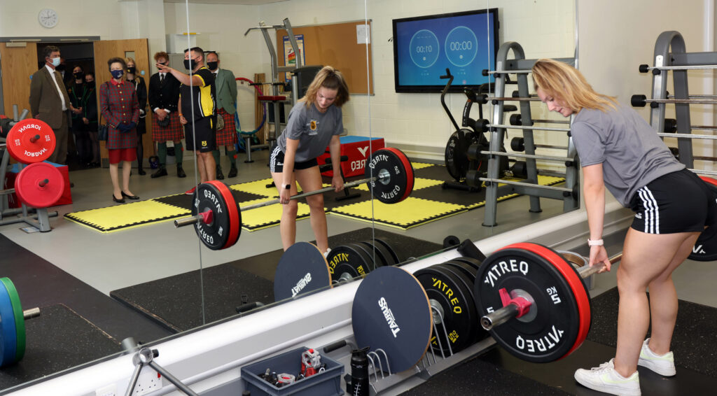 Her Royal Highness is shown the extensive gym facilities at the high school by head of PE Murray Hamilton.
