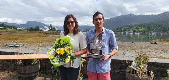 Commodore Fiona MacKenzie presented brother Alexander with the Plockton Trophy Race for Locals prize.
