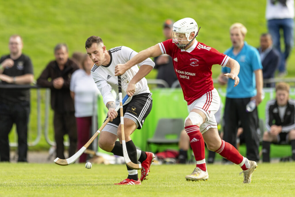 Kinlochshiel's Mark Macdonald tries to block Lewis Tawse of Lovat. Photograph: Neil Paterson.