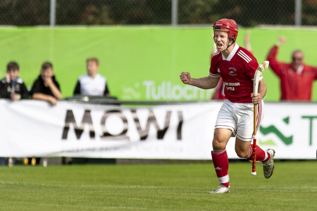 Kinlochshiel captain Keith Macrae celebrates scoring the first goal of his hat-trick in the Camanachd Cup Final versus Lovat at Mossfield, Oban. Photograph: Neil Paterson.