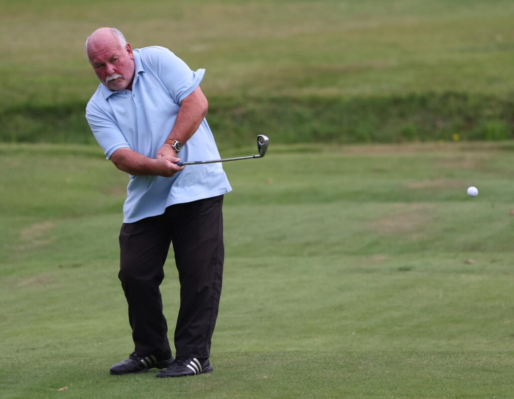 Davie Laird chips on to the third green. Photograph: Kevin McGlynn