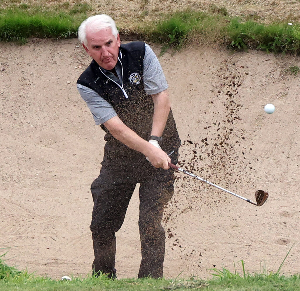 Neil Armour plays from the sand on the  6th hole. Photograph: Kevin McGlynn