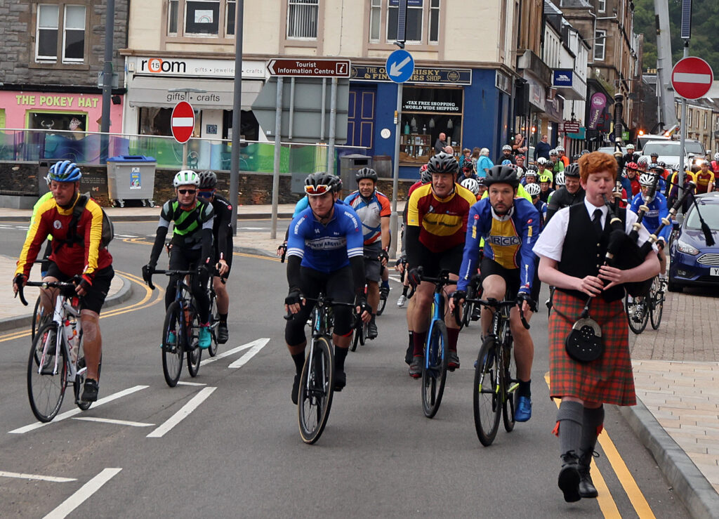 Piper Callum MacInness leads out the competitors. Photograph: Kevin McGlynn