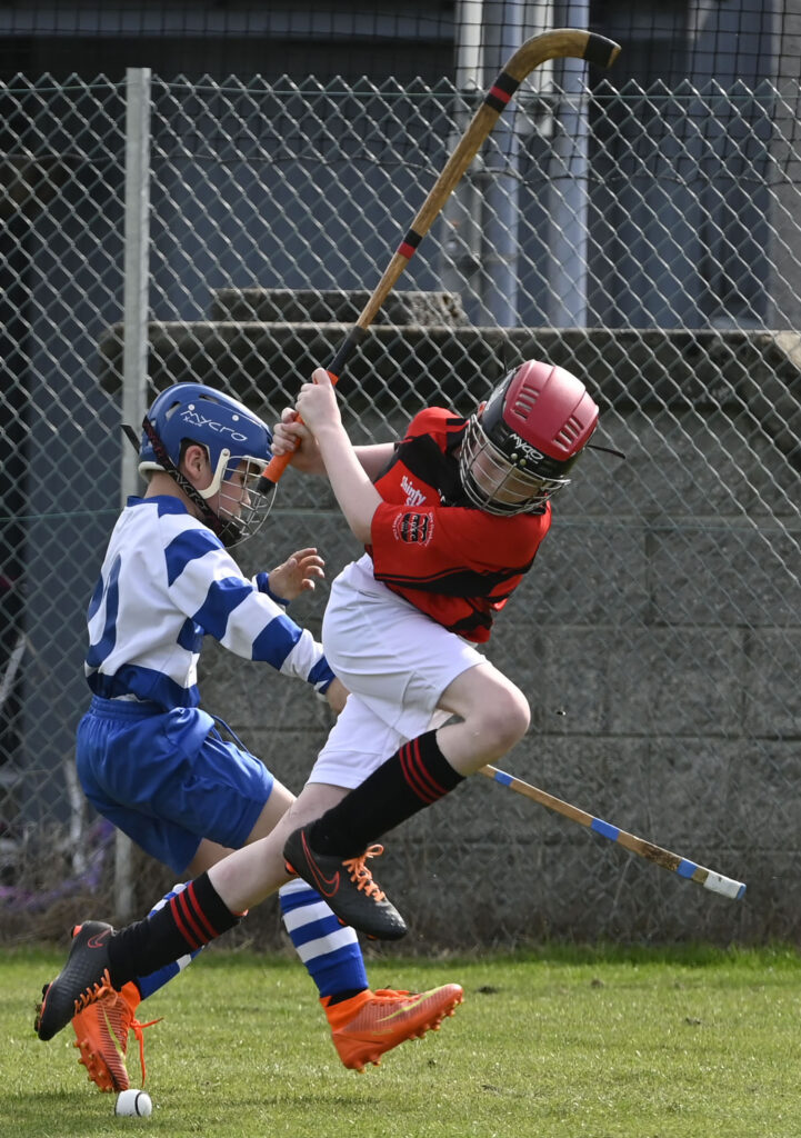 An action packed game between Newtonmore and GlenUrquhart/Balnain in the Tulloch Cup finals. Photograph: Iain Ferguson, alba.photos.